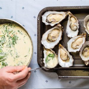 Adding dressing to Achill Oysters before cooking